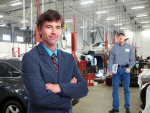 auto repair shop owner and tech